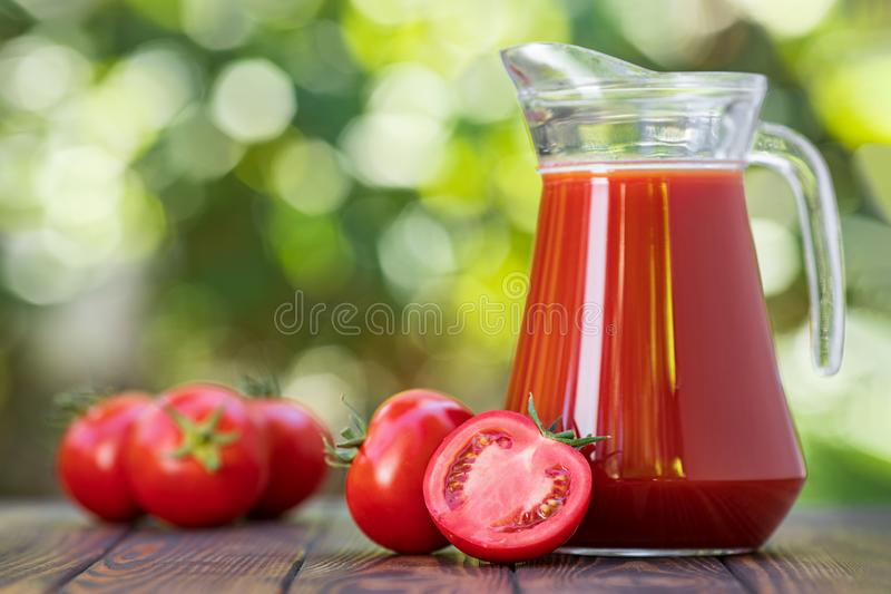 Tomato juice in glass jug royalty free stock photo