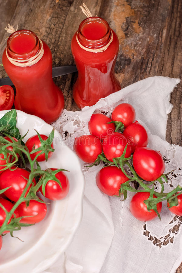 Tomato juice (tomato smoothie) - healthy beverage, refreshing drink. In jar on rustic table stock photo