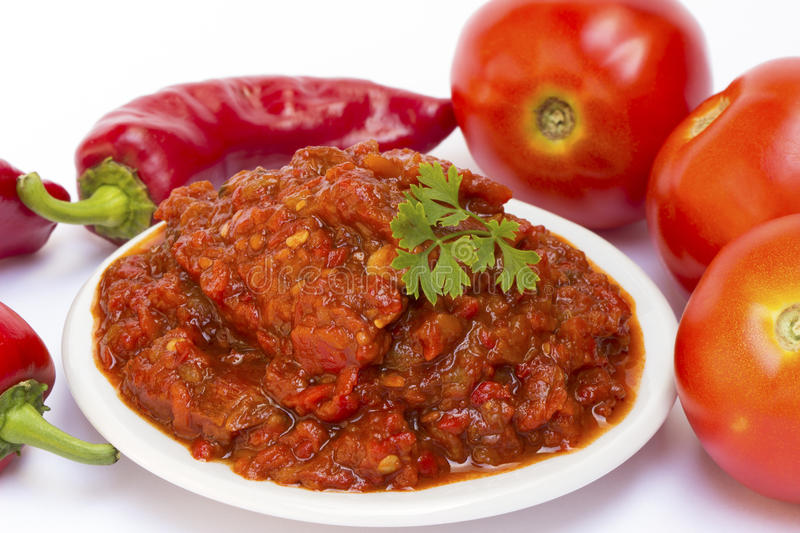 Tomato ketchup with red pepper. Lutenica - traditional pepper and tomato relish from the Balkans stock image