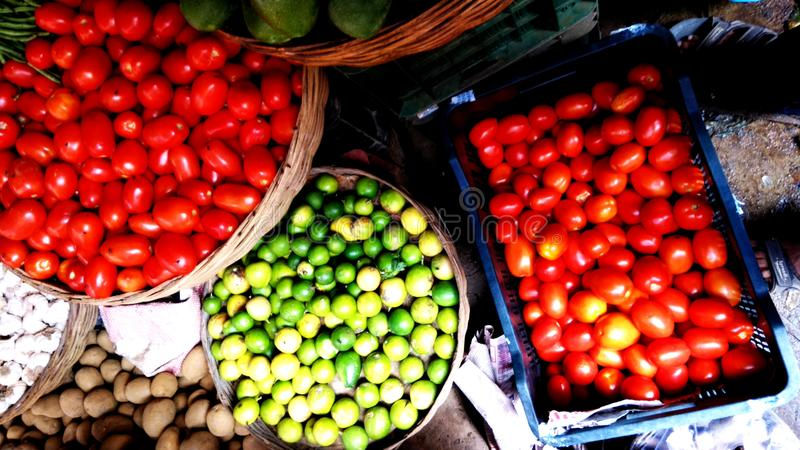 Tomato, lemon etc vegetables in a village shop stock photo