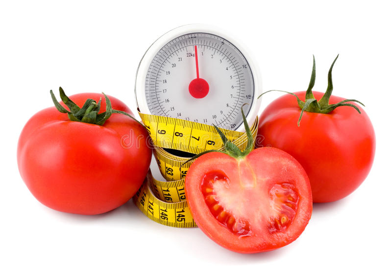 Tomato and measuring tape royalty free stock photos