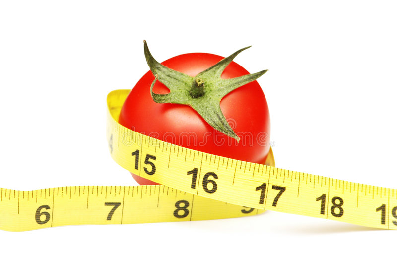 Tomato and measuring tape stock photography