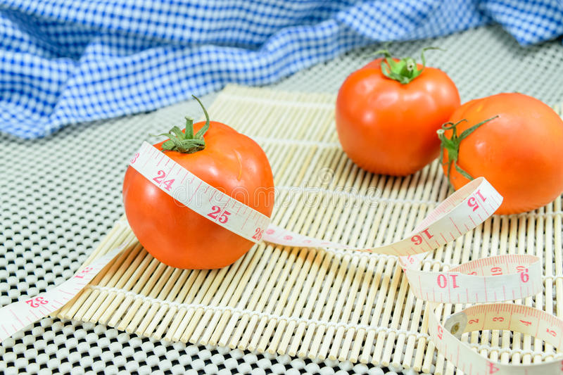 Tomato with measuring tape stock images
