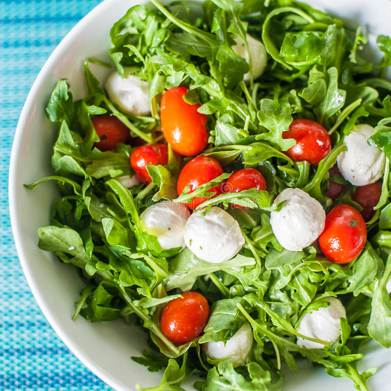 Tomato and Mozzarella Salad. (Tomato and Mozzarella Salad) Insalata caprese (literally, the salad from Capri) is the perfect summertime dish for cooks in a hurry royalty free stock photography