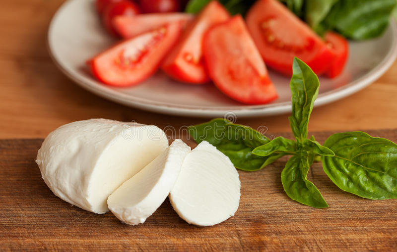 Tomato and Mozzarella slices with basil leaves. Caprese Salad. Tomato and Mozzarella slices with basil leaves royalty free stock photos