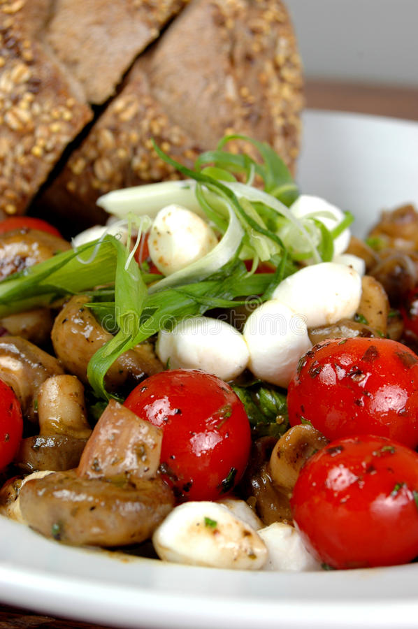 Tomato and mushroom salad royalty free stock images