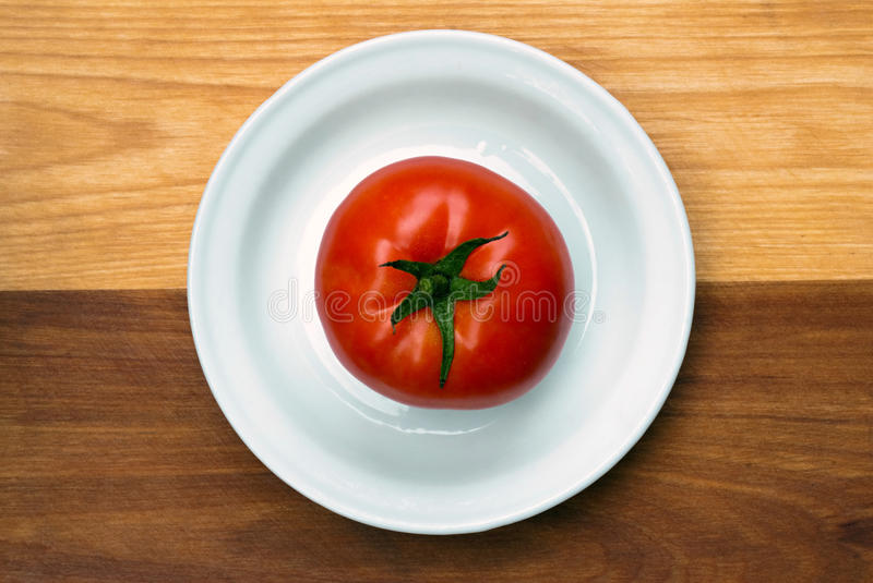 Download Tomato on a Plate stock image. Image of plate, fruit - 27295327