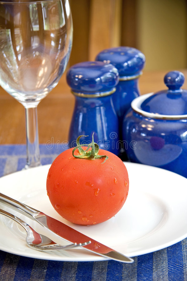 Tomato on a plate stock photos