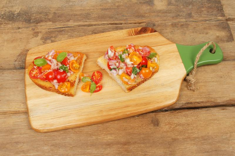 Download Bruschetta on rustic wood stock photo. Image of brown - 109857702