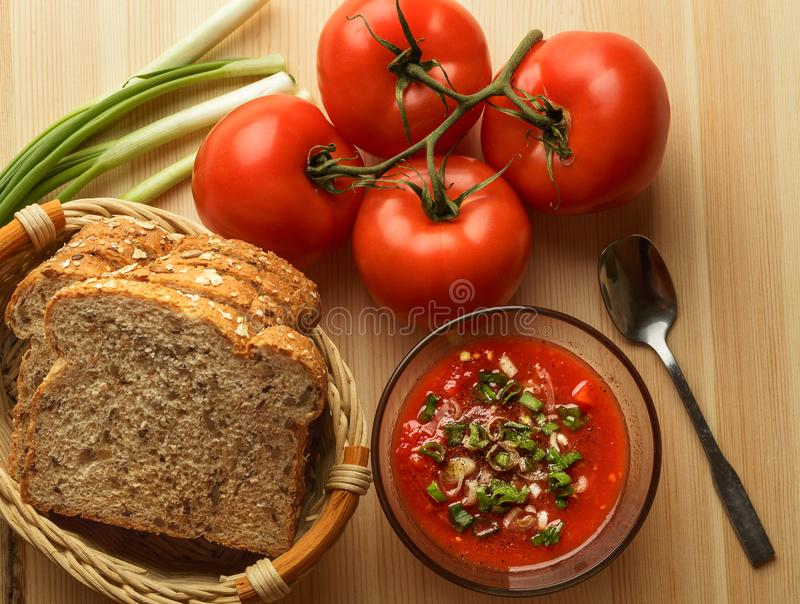 Tomato sauce in glass bowl, fresh bread, onion on wooden table, sauce ingredients for homemade vegetarian food, top view royalty free stock images