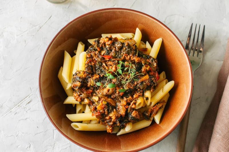 Tomato sauce ground beef pasta on a white stone background. Tone stock photos
