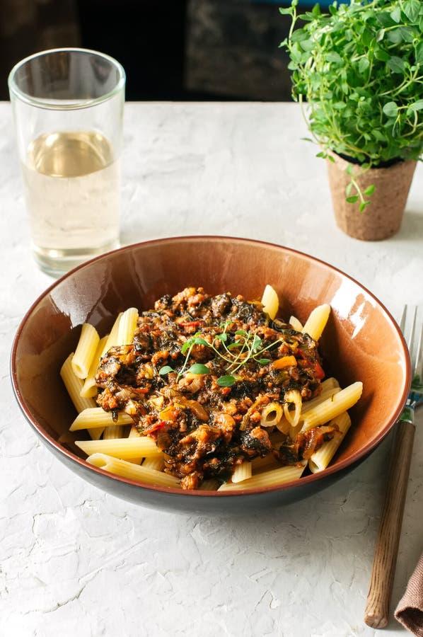 Tomato sauce ground beef pasta on a white stone background. Tone stock photo