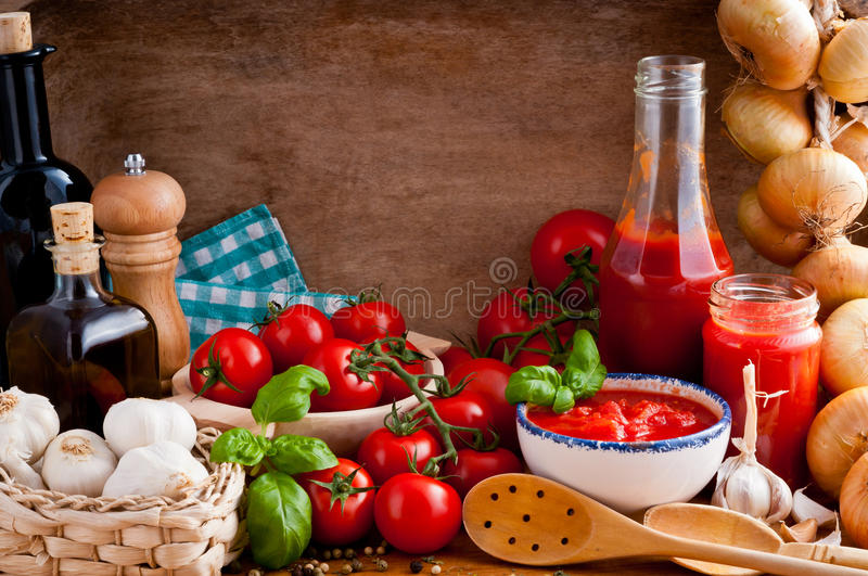 Tomato sauce and ingredients royalty free stock photo