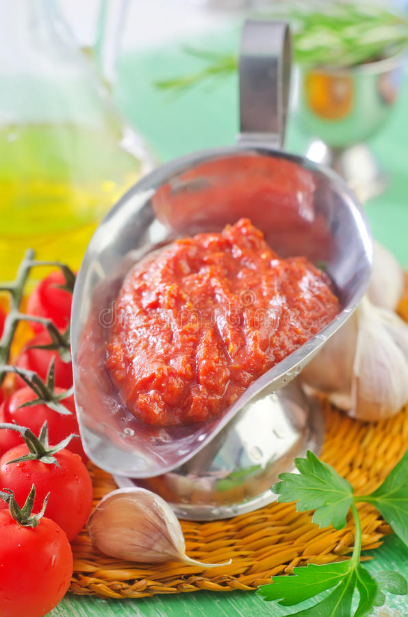 Tomato sauce. And ingredients for sauce stock images
