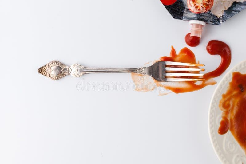 Tomato sauce splashes on white backgrounds royalty free stock photography