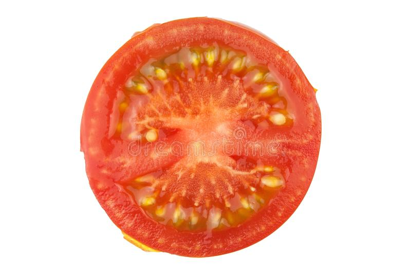 Tomato slice isolated on white background, top view. Fresh home-made vegetables. Growing tomatoes. Preparation of vegetable salad. Vegetarian food royalty free stock images