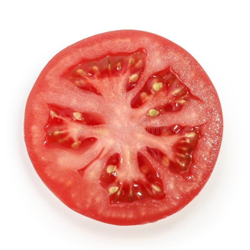 Tomato slice on white background stock photography