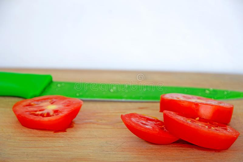 Tomato Slices and Knife on Chopping Board royalty free stock photo