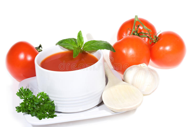 Tomato soup with basil leaves and vegetables royalty free stock image