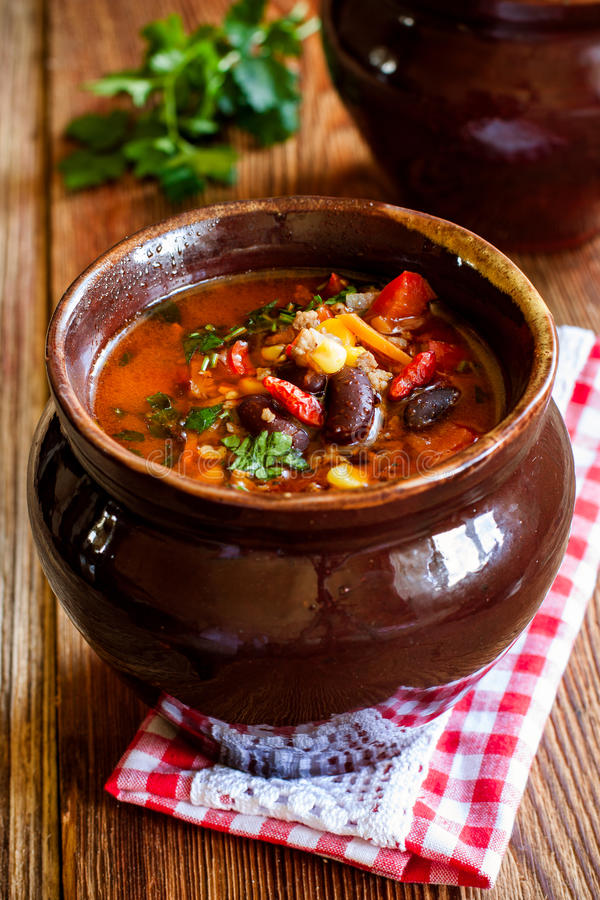 Tomato soup with beans, corn, vegetables and minced meat royalty free stock photography