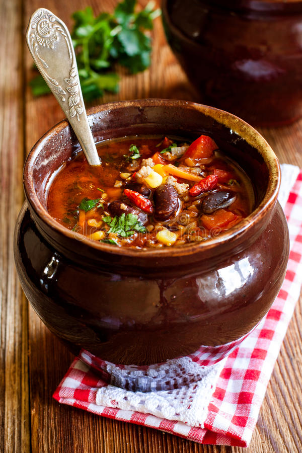 Tomato soup with beans, corn, vegetables and minced meat stock photo