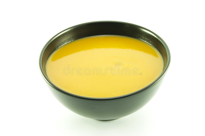 Tomato Soup in a Black Bowl royalty free stock image