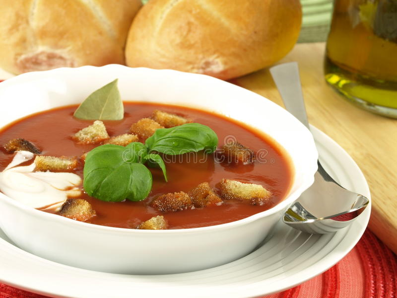 Tomato soup with croutons stock photography