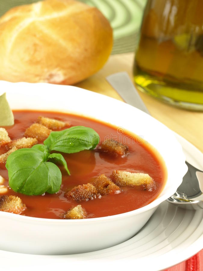 Tomato soup with croutons and bread stock image