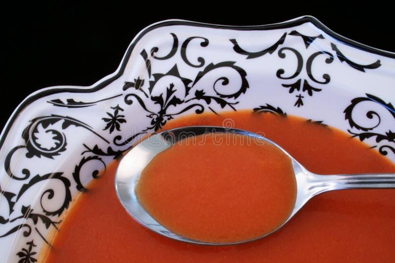 Tomato soup in an elegant bowl stock photo