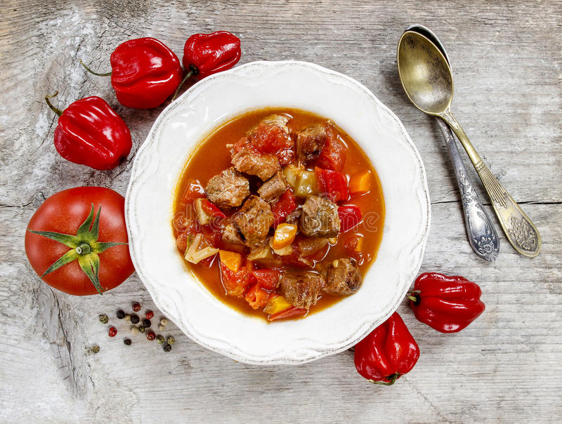 Tomato soup with fresh vegetables and meat royalty free stock photography