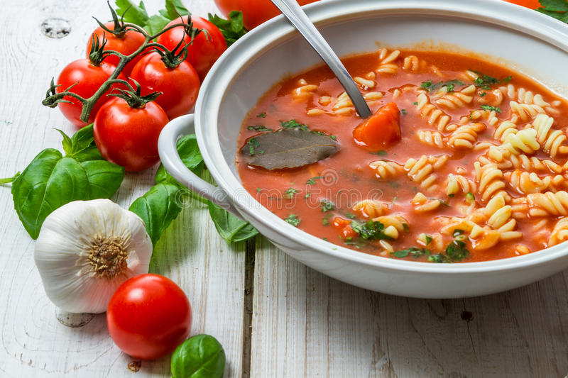 Tomato soup with garlic and basil stock photo
