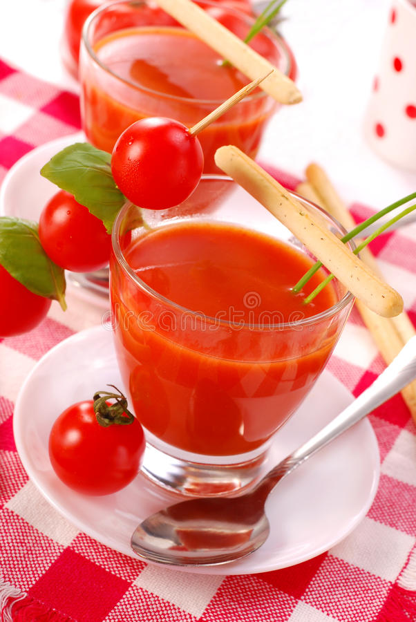Tomato soup with in glass stock photo