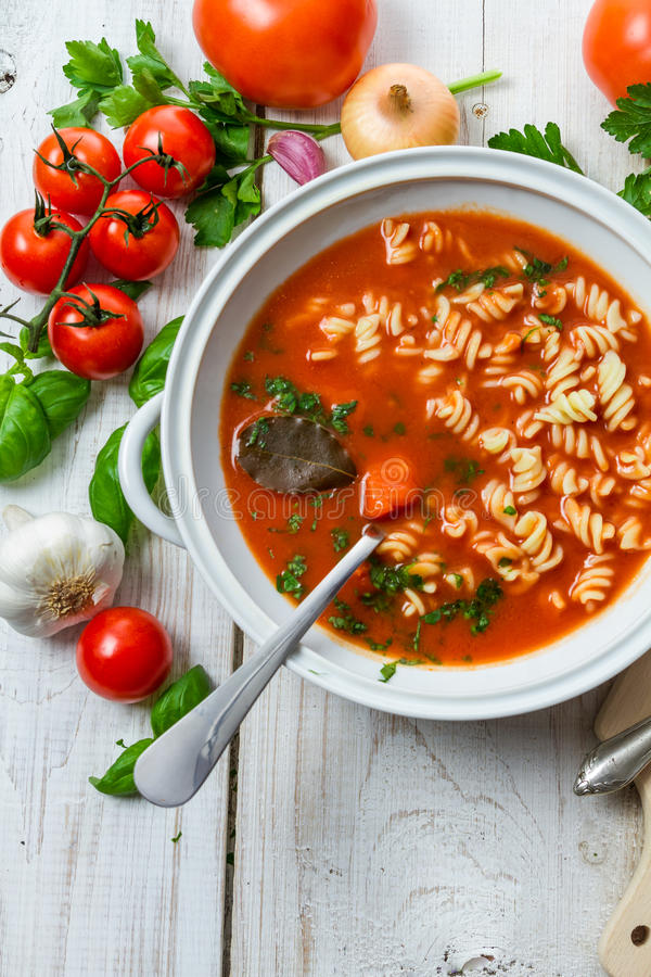 Tomato soup and ingredients for her royalty free stock image