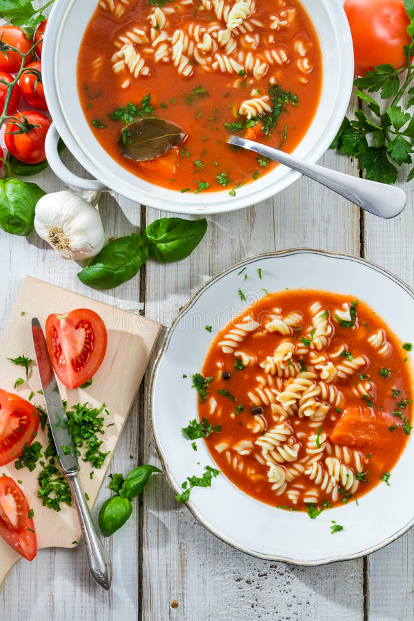 Tomato soup with noodle and ingredients royalty free stock images