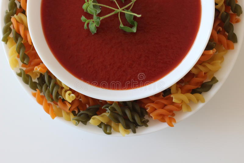 Tomato soup and noodles, royalty free stock image