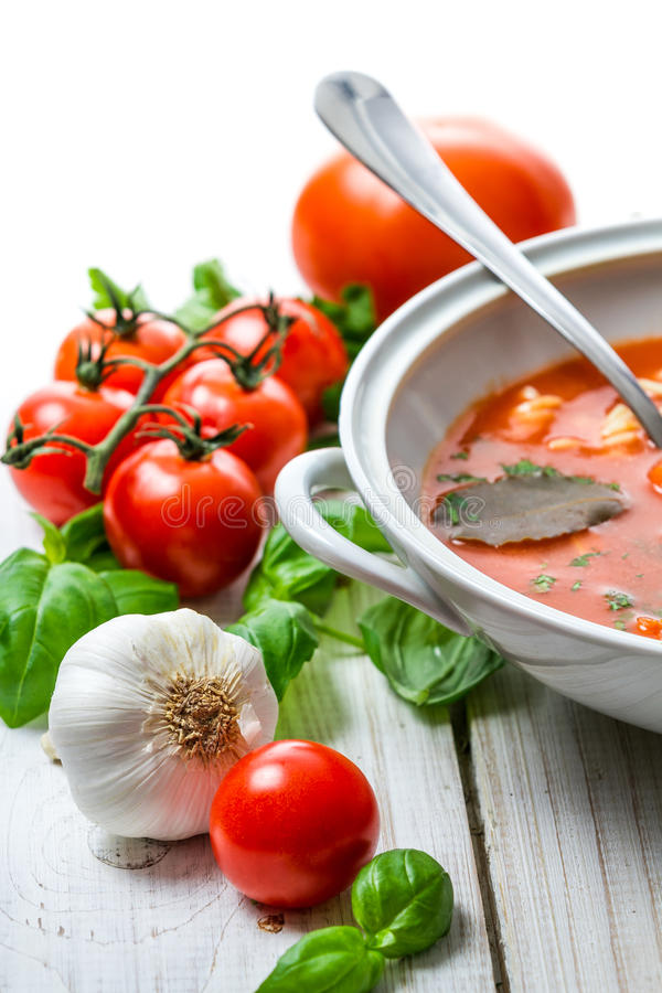 Tomato soup with noodles and fresh vegetables stock photos