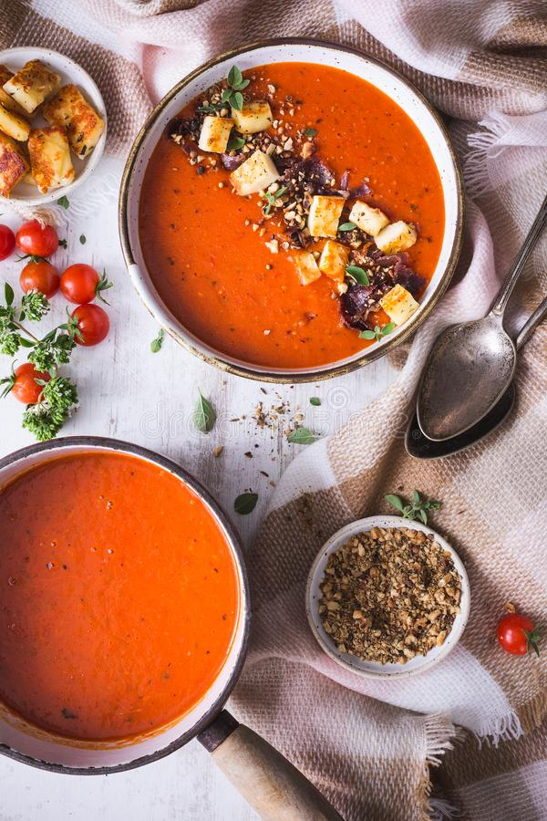 Tomato Soup with Red Pepper, Halloumi, Dukkah Spices and Oregano royalty free stock images