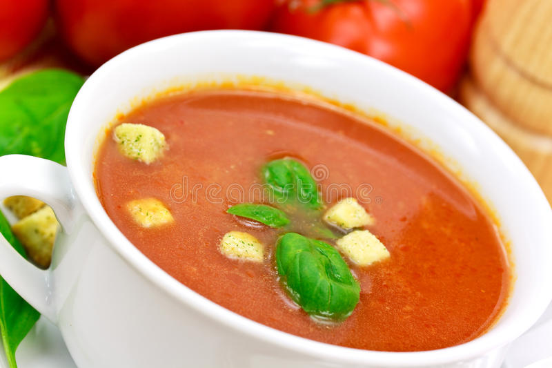 Download Tomato soup in white bowl stock image. Image of leaves - 10297233