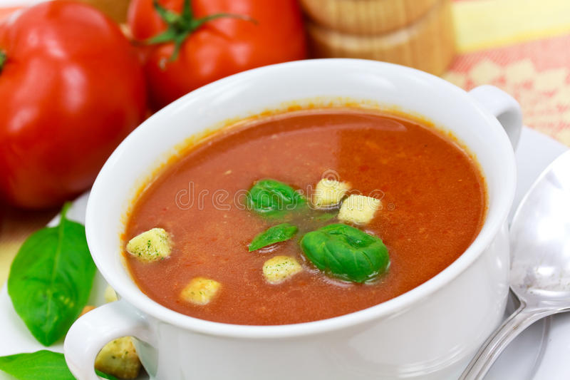 Tomato soup in white bowl stock photography