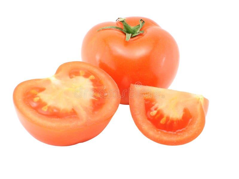 Tomato and tomato segments royalty free stock photos