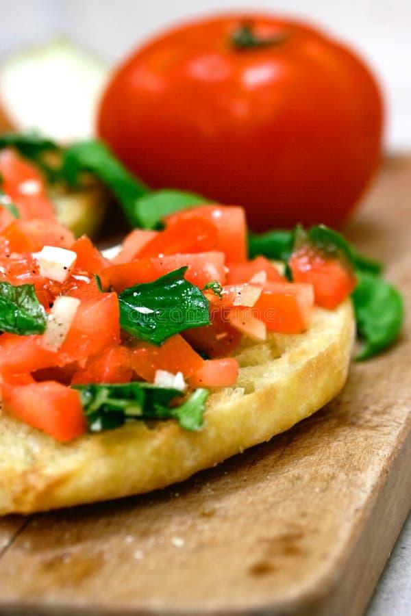 Tomato topped bruschetta stock photography
