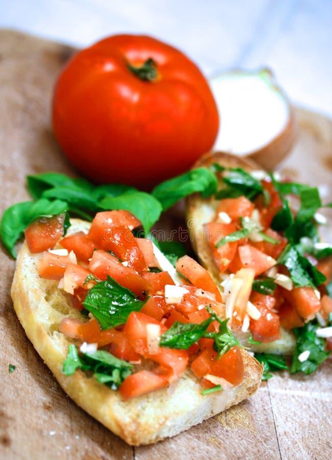 Tomato topped bruschetta royalty free stock photos