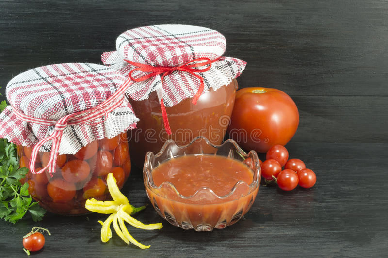 Tomato in various forms. On dark background royalty free stock image