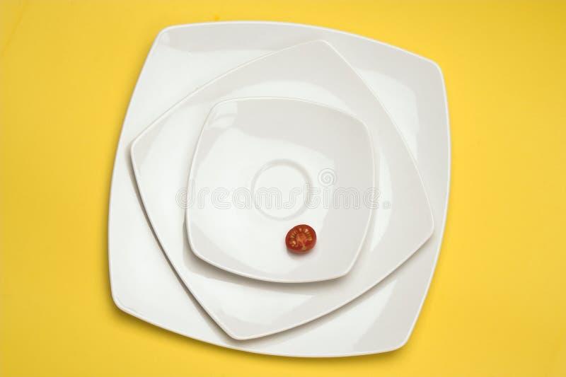Tomato in white plate stock photo