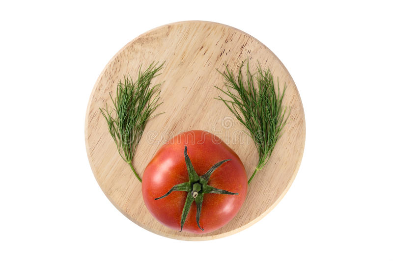 Tomato with wings of dill royalty free stock photography