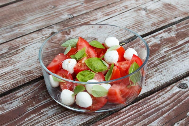 Tomatoe e salada do mozzarella imagem de stock