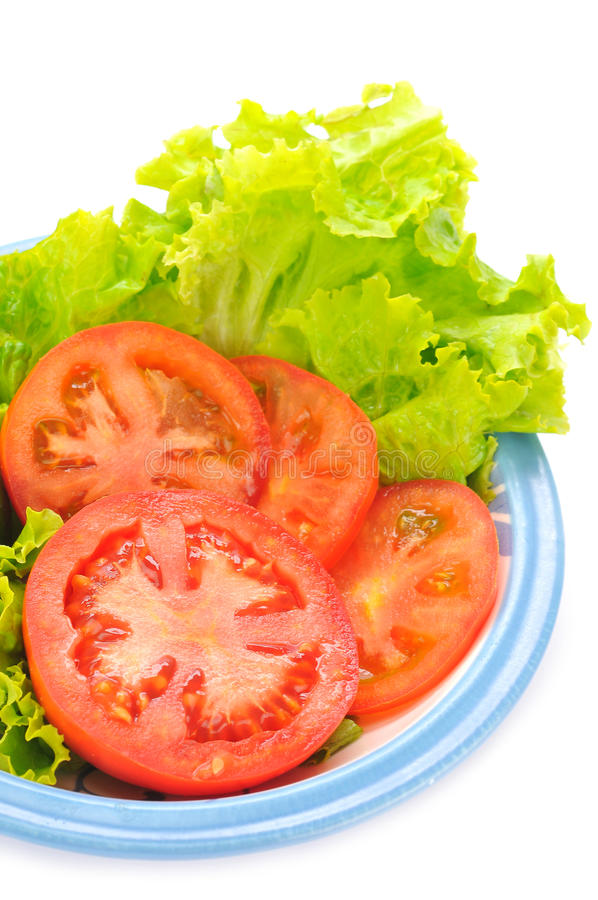 Tomatoe en sla royalty-vrije stock afbeelding