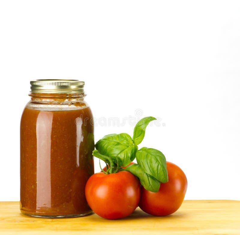 Tomatoe sauce tomatoes and basil stock photography