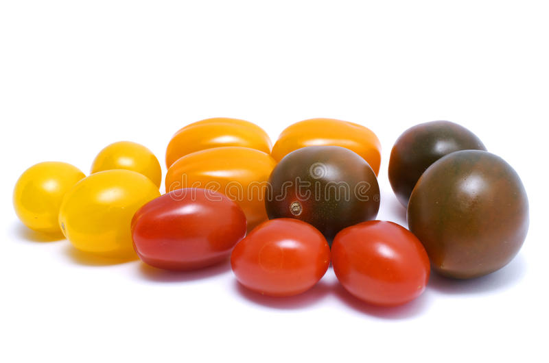 Tomatoes. Cherry tomatoes of different varieties, isolated stock photography