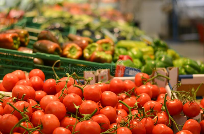 Tomatoes and all varieties of fruit and vegetables in large distributions. Buying and selecting in the supermarkets of shopping malls, is now a habit of millions royalty free stock photo